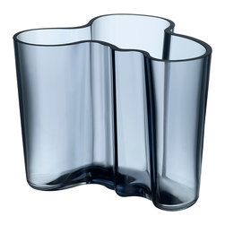 """iittala Aalto Vase 4.75"""" Rain - The Aalto Vase is part of the Alvar Aalto Collection for Iittala and is one of the most iconic and enduring pieces of Finnish design. Sometimes called the Savoy Vase because it was designed by Alvar Aalto and his wife Aino Aalto for the Savoy restaurant in Helsinki, Finland, the vase was displayed at the 1937 World's Fair in Paris. The Aalto vase was originally inspired by the hem of a woman's dress of the Sami people, an indigenous people that live in northern Sweden, Finland and Norway."""