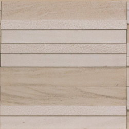 Areia Limestone Portugal Collection - Areia tiles come in three patterns of alternating honed, brushed and sandblasted stone pieces and are available in a flat or dimensional face. The color is a light sandy beige.