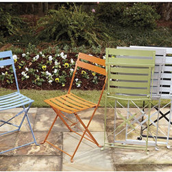 Ballard Designs - Cafe Folding Chairs - Set of 2 - There are lots of ways you can go with dining chairs, but the colors on these outdoor ones make me happy. Plus, they are so open and light that they won't visually weigh down the room.