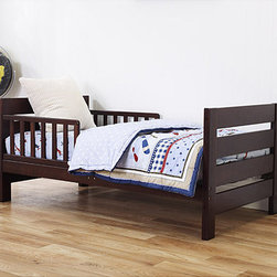 DaVinci - DaVinci Modena Toddler Bed - Graduate your child from a crib to this trendy toddler bed. The frame is New Zealand pine with a great finish. It sports a modern,sleek design. With this bed,your child is sure to enjoy the transition from a baby to child.