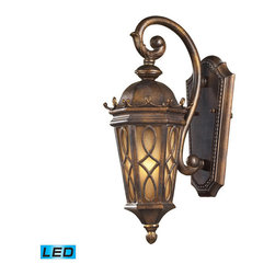 Elk Lighting - Elk Lighting Burlington Junction 1 Light Outdoor Sconce in Hazlenut Bronze & Am - 1 Light Outdoor Sconce in Hazlenut Bronze & Amber Scavo Glass belongs to Burlington Junction Collection by Located On The Eastern Shore Of Lake Champlain Between The Adirondack And Green Mountains, Burlington Is Charming And Idyllic. This Series Was Inspired By This Quaint City By The Lake That Prides Itself In The Arts. The Fine Craftsmanship Of This Collection Is Evident In The Cast Aluminum Details And Scrollwork. This Series Is Available With Two Glass Options; A Clear Seeded Glass Or Amber Scavo Glass. - LED Offering Up To 800 Lumens (60 Watt Equivalent) With Full Range Dimming. Includes An Easily Replaceable LED Bulb (120V). Sconce (1)