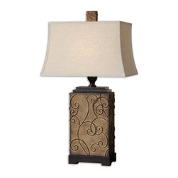 Uttermost - Calvina Decorative Rustic Metal Accent Lamp - This  decorative  rustic  metal  accent  lamp  has  unique  features  to  it.  Made  with  a  metal  base  and  embossed  with  rustic  bronze  curled  details.  Topped  with  an  ivory  rectangular  shade,  this  rustic  lamp  has  an  airy  feel  to  it.  Great  for  any  home  or  office.  Click  here  to  see  the  complete  line  of  lamps  that  we  offer.