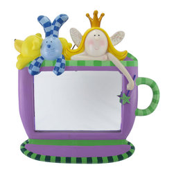 Purple and Green Princess and FriendsTea Cup Mirror - This mirror is an adorable accent to any little girl`s room! It is shaped like a tea cup, and has a fairy princess and her friends peeking over the top. Made of cold cast resin, it measures 18 1/2 inches tall, 18 inches wide, 3 inches deep, with the mirror portion measuring 10 3/4 X 7 1/2 inches. Each piece is hand painted with a pleasing combination of colors, and the glittery fairy wings and wand add just the right amount of sparkle. The mirror can stand alone on a flat surface, or be mounted to the wall.