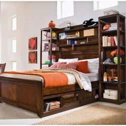 Elite Expressions Bookcase Storage Bed - The Elite Expressions Bookcase Bed will help you organize all your books, mementos, and personal accessories around and underneath your bed. It consists of five main components: panel bed frame, under-bed drawer box, bridge with shelves, and two bookcase piers. The panel headboard and footboard feature thick, handsome frames, while the slat roll mattress support system is made up of evenly spaced wooden slats that run the whole length of the bed. This system provides all the support your mattress will need, so you won't even need a box spring. The convenient under-bed drawer box has two open shelves and two smooth-gliding drawers. The drawers feature heavy drawer front frames, which act as handles and create a subtle, geometric design.A bridge with shelves stretches above the headboard and connects the two bookcase piers. The bridge has two wide shelves (including the top surface) and two sliding doors with open compartments. You can hide or reveal whichever portion of this shelf you want, and a wire management hole makes it easy to hook up an alarm clock or stereo. The two bookcase piers each have five fixed shelves that can accommodate numerous books and decorative accents. An optional 5-drawer chest with framed drawer front handles, a removable divider in the top drawer , and English dovetail construction for superior strength is available with The Elite Expressions Bookcase Bed. A nightstand with one large open storage shelf and one drawer with framed drawer front handles is available as an option with this bed, too. Part of Lea's Elite Expressions collection, this bookcase storage bed is crafted from select cherry veneers with warm undertones and matched cherry veneer drawer fronts. The root beer cherry color finish is the result of an extensive, multi-step finishing process. This versatile bed offers lasting style that works for youth, teen, and even smaller master bedroom settings. Available in your choice of sizes. What makes this collection elite: The Lea Elite Collections are crafted from high quality materials usually associated with more expensive, heirloom quality furniture. Pattern veneers, inlays, and matched veneer drawer fronts are a few characters that set these collections apart from the rest. The multi-step finishing process begins with hand-selected veneers and involves as many as seven different spray applications and as many as eight additional hand applications. Together, these layers create a high-luster finish that accentuates the wood veneers. All finishes are lead-free, child-safe, and meet US safety requirements.Dependable Bed Construction: All Elite Collections beds feature metal connectors that prevent unintentional rail detachment and provide strength and lasting durability. Slat roll mattress support systems come standard with bunk beds, loft beds, and platform beds to provide reliable mattress support without the need for a box spring or bunkie board. Each slat fastens with a screw, which increases the structural integrity of the bed. Most twin and full size Elite Collections beds have under-bed storage options, including deep drawers or dual-function trundle/storage units, that take advantage of unused space under the bed.Superior drawer construction: The deep under-bed drawers feature traditional English dovetail construction on drawer fronts and drawer backs, providing more strength and durability than commonly used French dovetail or box joints. Drawer parts are hand-sanded and finished with a stained, protective top coat to create a smooth, snag-free interior. Drawer bottoms are reinforced by corner blocks and center rails for greater stability.The drawers operate smoothly on full-extension drawer guides with steel ball bearings that provide easy, one-handed operation and better drawer stability than standard center-mounted drawer guides. Because the drawers extend completely out of the case, you have easier access to the contents of the drawer - even way in the back. Automatic drawer stops prevent drawers from falling out. Select drawers include special features, such as aromatic cedar bottoms or removable drawer dividers.Bed Dimensions:Twin:Complete bed: 80L x 59W x 72H inchesPanel headboard: 41W x 2D x 46H inchesPanel footboard: 41W x 1D x 22H inchesRails with slats: 76W x 2D x 5H inchesBridge: 50W x 8D x 28H inchesBridge top opening: 38W x 7D x 7H inchesBridge center compartment: 16W x 7D x 6H inchesBridge outside compartments: 11W x 6D x 7H inches eachFull:Complete bed: 80L x 74W x 72H inchesPanel headboard: 56W x 2D x 46H inchesPanel footboard: 56W x 1D x 22H inchesRails with slats: 76W x 2D x 5H inchesBridge: 65W x 8D x 28H inchesBridge top opening: 53W x 7D x 8H inchesBridge center compartment: 23W x 7D x 5.5H inchesBridge outside compartments: 14W x 6D x 5H inches eachFor both Twin and Full sizes:Under-bed drawer box: 76L x 18W x 12H inchesOpen shelves in drawer box: 16W x 18D x 8H inches eachBookcase pier: 18W x 14D x 72H inchesBookcase openings: 17W x 13D inches eachChest & Nightstand DimensionsChest: 36W x 18D x 50H inchesNightstand: 22W x 17D x 27H inchesAbout Lea IndustriesLea Industries is a leading manufacturer of youth furniture. Each piece is crafted from fine hardwoods, veneers, wood products, and simulated wood to ensure both durable and quality furniture that will stand up to years of wear and tear. Lea's youth furniture offers a wide assortment of styles for both girls and boys, with a broad selection of specialized, functional designs, including four-poster canopy beds, bunk beds, storage beds, dual sleep beds, student desks, and learning centers for youth computing. Lea's wide variety of styles ranges from 18th century and country to casual contemporary. Lea traces its origins back to 1869. Their headquarters is located in Greensboro, N.C.
