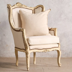 "Eloquence - Eloquence One of a Kind Vintage Bergere Louis XV Old Vanilla Cream - The Eloquence One of a Kind collection offers the warmth and character of authentic vintage finds. This Louis XV-style bergere accents a living room or bedroom with French-inspired elegance. Showcasing an old vanilla cream finish with gilt highlights, the sophisticated seat displays beautiful carvings, cabriole legs, duck canvas upholstery and nailhead trim. Circa 1940. 29""W x 24""D x 41""H. Seat: 19""H. Arm: 25""H."