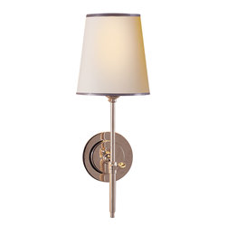 Bryant Sconce - Slim in design but not slim on style, this slender sconce carries a lot of visual weight. The petite frame makes it a great choice for walls that need a little pick-me-up without feeling too heavy. Frame your bed or a favorite painting with two, or use three to light your hallway for a big impact.