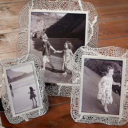 Espera Photo Frame - 8 x 10 - Whether you use the Espera 8x10 Photo Frame for a formal school or wedding portrait, for your own highest achievement in nature photography, or for a treasured ancestral carte de visite, the fine mesh of bubble-like cells which make up its organically curving outline will be a perfect surrounding.� This is because the frame, which is glamorously based on the natural features of the sea fan, is plated in brilliant nickel for lasting gleam.