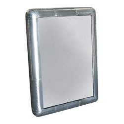 Kathy Kuo Home - Yeager Aviator Industrial Loft Stainless Steel Rectangular Wall Mirror - Prepare for take-off every morning in front of this rectangular, stainless steel masterpiece of a mirror. The metallic finish holds hundreds of hand-drilled screws, adding decorative detail to this Industrial Loft piece, perfect for a bathroom, guest room or anywhere you require a reflection of your good taste.