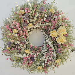 Frontgate - Spring Garden Wreath - Handmade of dried flowers. All flowers are grown in the Pacific Northwest, where the wreath is manufactured. Hang indoors or in a sheltered outdoor area away from sun and moisture. 18% pale green avena, 18% flax, 18% white larkspur, 18% pink larkspur, 18% lemon mint, 10% yellow waxed mulberry paper roses. Arrives ready to hang. Dried flowers, in vibrant colors of this pink, yellow, white, and lavender Garden Wreath, are a welcome reminder of spring. Like a flourishing garden, this handmade design overlays colors and textures of green avena, white and pink larkspur, flax, and lemon mint – and then draws the eye to the large and small yellow roses made out of organic mulberry paper.  .  .  .  .  . Made in the USA.