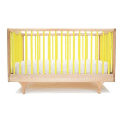 Kalon Studios - Kalon Studios Caravan Crib, Yellow - Inspired by the storybook circus wagon, the Caravan Crib plays with classic form and contemporary, ultra-bold colors. Thoughtfully considered, the Caravan Crib meets modern parent's needs: