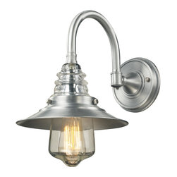 Elk Lighting - EL-66702-1 Insulator Glass 1-Light Outdoor Sconce in Brushed Aluminum - The Insulator Glass Collection was inspired by the glass relics that adorned the top of telegraph lines at the turn of the 20th century.� Acting as the centerpiece of this series is the recognizable shape of the glass insulator, made from thick clear glass that is complimented by solid cast hardware designed with an industrial aesthetic. Finishes include polished chrome, oiled bronze, and weathered zinc.