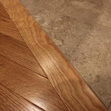 Traditional Hardwood Flooring by OakWood Renovation Experts