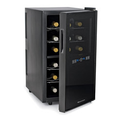 "Wine Enthusiast - 18 Bottle Dual Zone Touchscreen Refrigerator - Store and serve from 2 separate zones! A freestanding wine refrigerator with reflective smoked glass. Ideal storing conditions for reds and whites. Dimensions: 25-3/4""H x 14-1/4""W x 20""D. Two zones: top holds 10 bottles, bottom holds 8. Top zone 54-66F, bottom zone 46-66F. Digital touchscreen with temperature display. Thermopane door, 4 pull-out chrome shelves. Interior LED lighting."