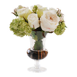 Jane Seymour Botanicals - Roses in Glass - Enjoy the look of fresh-cut flowers in your home without the trip to the florist. This magnificent permanent bouquet of creamy white roses and lime viburnum is handsomely displayed in a footed glass vase with water illusion and river rock pebbles for an added element of realism. The fact that it's faux can be your little secret.