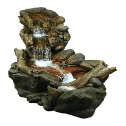 """Lamps Plus - Rainforest Creek Three-Tier LED Fountain - Setting a beautiful scene straight from the wilderness this three-tier fountain mimics the look of mountain stream water as it dribbles down a rocky creek. Driftwood adds a realistic touch while LED lights give the catch basin a subtle glow. Fiberglass construction. Includes LED lights. Includes 6' cord. 28"""" high. 26"""" wide. 59"""" deep.  Rainforest Creek water fountain.  Three tiers of cascading water.  LED in top and bottom basins.  Faux stone and log finishes.  Lightweight fiberglass construction.  Comes with pump.  6-foot cord.  59"""" deep.  26"""" wide.  28"""" high."""