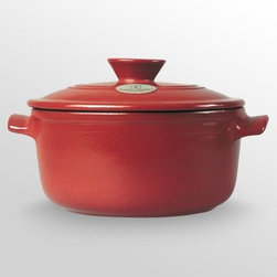 Emile Henry Ceramic 10 in. 5.5 qt. Flame Top Round Dutch Oven with Lid - Simmer soup or braise a pork roast. From inside the oven or stove top, this flameproof Dutch oven can take the heat, making it an efficient and versatile addition to your kitchen. More on Emile Henry's Flame Ceramic Cookware:This new ceramic technology allows for cooking in the oven or microwave, or on the grill or stove - regardless of whether you're working with gas, electricity, or halogen. With Emile Henry's special induction disk, Flame Ceramic Cookware can even be put to use on induction stove tops. Wherever you put it to use, this unique ceramic material provides even heat distribution, coaxing out the natural flavors of food and maintaining natural textures and colors. The all-important result is better tasting dishes.Retains heat longerEasy to clean, dishwasher-safeLightweight and easy to handle - 30% lighter than cast IronFooted base for heat diffusionCan be heated to extremely high temperatures for searingManufactured in France from Burgundy Clay and other natural products10-year warranty for household use