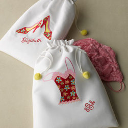 Zazendi - Zazendi Floral Cami Bag, Personalized - White cotton bags with yellow pom-pom drawstrings are appliqued with a floral cami or shoe design to help organize your wardrobe while traveling. Both bags are also available with optional personalization. Imported. For personalization in typestyle and...