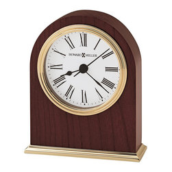 Howard Miller - Howard Miller Craven Table Top Clock - Howard Miller - Mantel / Table Clocks - 645401 - This contemporary table clock can be customized with an engraving plate to create a memento for your tabletop or wall. Distinguished by its triple-rim polished brass tone dial bezel and base and classic white dial the Craven has a nice glow to it. Beautiful hardwood framing in a rosewood finish and quality quartz movement operation complete the look and appeal of this accent clock.
