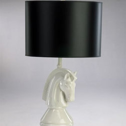 Chess Knight Table Lamp - Equestrian style meets the chess board meets Hollywood Regency in this crisp black and white horse head lamp. It holds its own by itself but would also be great in a pair on a long console table or flanking a bed.