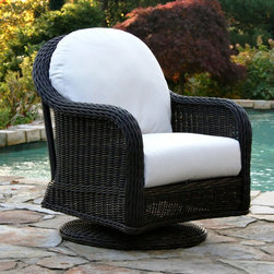 Anacara Mariner All-Weather Wicker Swivel Glider Lounge Chair - Additional features: Designed for outdoor use - can be used indoors too! Generously proportioned, oversized design for maximum comfort Convenient swivel feature Comes fully assembled There's nothing like sinking into the Anacara Mariner All-Weather Wicker Swivel Glider Lounge Chair with a cool drink at the end of a day's work. The oversized design, along with the convenient swivel feature, offer so much comfort that you might just be tempted to spend every waking hour outdoors! Characterized by a large braided weave, which is beautifully turned to make a very comfortable sloping arm, and a traditional weave pattern reminiscent of the South Pacific, this swivel glider lounge chair is sure to be the highlight of any patio or porch. Woven over a durable, welded aluminum frame, the all-weather resin wicker mimics the look of natural willow, while subtle variations in color brought about by interweaving varying shades of resin wicker, help highlight its natural willow look. And the best part is that you can leave this swivel glider outdoors all year long and all you'd need to do by way of maintenance is just hose it off to clean! The deep, plush seat and back cushions are available in your choice of a variety of different designer options, from muted solids to brightly patterned prints. Fabric Options:Choose from to grades of fabric. Grade A is an outdoor fabric with a printed color or pattern. Grades B is a solution-dyed fabric. Both are designed for outdoor use, however Grade B fabrics, that differ only slightly in their manufacturing process, are more fade resistant. Solution dying refers to the color being soaked into each thread. Printed fabrics have the color on the top side of the fabric only. We recommend Grade B fabrics for extremely sunny regions or patios that are in direct sunlight. Grade A fabrics are amazing quality fabrics, but will fade quicker than Grade B when used in direct sunlight. Grade A fabrics have a 1-year fade warranty and Grade B fabrics have a 2-year fade warranty. Important NoticeThis item is custom-made to order, which means production begins immediately upon receipt of each order. Because of this, cancellations must be made via telephone to 1-800-351-5699 within 24 hours of order placement. Emails are not currently acceptable forms of cancellation. Thank you for your consideration in this matter.