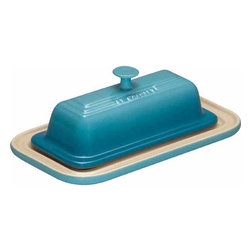 Le Creuset - Le Creuset Stoneware Butter Dish - Not only is the stoneware butter dish a decorative piece for the table during meal time, but its also a functional tool in the kitchen, able to go from the refrigerator to the microwave to soften butter for easy spreading during meals. The butter dish stoneware construction also means it retains cooler temperatures longer, helping sticks of butter stay together on a warm outdoor table.