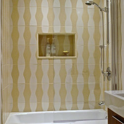 "Bathtub Shower Screen Installations - Sleek alternative to shower curtains.  Semi-frameless Ark Shower Screen, 70 inches high by 33.5 inches wide, clear tempered 5/16"" (8mm) glass with rounded top corner.   Polished silver (anodized) finish.  As functional as a shower curtain but almost invisible, helping to make a small bathroom look much bigger.  Model 7008SPR"