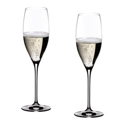 Riedel - Riedel Vinum Cuveé Prestige Glasses - Set of 2 - The magic of this glass is its ability to highlight the full spectrum of aromas and flavors offered by fine champagnes and sparkling wines while preserving their elegant effervescence. Bubbles pose a challenge. How do you keep the sparkle in sparkling wine? The solution lies at the bottom of each Vinum Prestige Cuvée Flute. Etched into each is a small dot, the purpose of which is to provide a slightly abraded surface that serves to generate a continuous stream of bubbles and prevent the champagne from going flat in the glass. Designed to highlight the bouquet of champagne, this light and well-balanced glass accentuates the complexity and richness of vintage champagnes and prestige cuvées. Recommended for: Cava, Champagne, Cuvée Prestige, Prosecco, Rosé Champagne, Sparkling wine, Vintage Champagne
