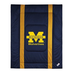 "Sports Coverage - University of Michigan Sidelines Comforter - This solid colored jersey mesh comforter is a great way to show support for your favorite team, and it makes the perfect gift for the ultimate fan. Each comforter looks and feels like a real jersey and has the team logo centered on solid team colors. It offers a machine washable design with warm and comfortable polyester fill. Sideline option adds a long mesh line along each side of the logo for a stylish effect. Comforters are available in Twin and Full/Queen sizes. Features: -Michigan Wolverines theme -Screen-printed team graphic -100% polyester jersey mesh -100% polyester fill -5.5 oz. bonded polyester batts -Machine washable -Made in USA -Twin size: 86"" H x 68"" W -Full/Queen size: 86"" H x 86"" W"