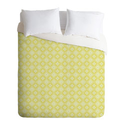 DENY Designs - Caroline Okun Yellow Spirals King Duvet Cover - Bedeck your bed with this easy-on-the-eyes duvet cover. The spinning spiral motif recalls the Op Art era, while the color combo is soothing and sleep-inducing. Got a set of patterned sheets? Flip to the solid-white underside.
