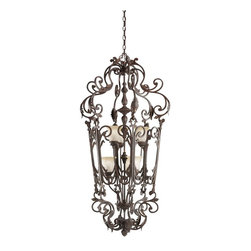KICHLER - KICHLER 2471CZ Rochelle European Traditional Foyer Light - A luxurious line of lighting that possesses a classic aesthetic with just a bit more ornamentation, you cannot do much better than this gorgeous 6-light Foyer fixture. The fixture's prominent romantic details include forged leaf accents and junction body covers with the shell-like curves of classic rococo, but softened to fit more comfortably into today's room settings. Adding to the look is a Creme Carmel glass which casts a soft, golden glow to bring elegant warmth to your lighting. The hand blown extra heavy glass is finished to resemble the color and texture of Creme Brule, and is a delightful complement to the richness of the Carre Bronze finish. It uses 60-watt (max.) bulbs.