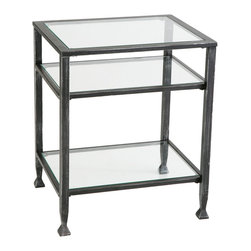 Holly & Martin - Guthrie Metal End Table - Two glass storage shelves and a tabletop make this glass and metal side table as functional as it is beautiful. With ample space for books, magazines and other goodies below, nothing will compete with your favorite drink for space. One must prioritize, right?