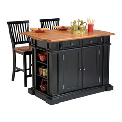 Home Styles - Home Styles Large Kitchen Island Set with 2 Stationary Stools - Antique Black & - Shop for Kitchen Islands from Hayneedle.com! The Home Styles Large Kitchen Island Set with 2 Stationary Stools - Antique Black & Oak offers a variety of culinary possibilities. Spacious and versatile this island is durably constructed of solid hardwoods and engineered wood with a sleek black finish and distressed oak finished top. Perfect for food prep and serving the top is all wood in distressed oak finish. When you need a bigger work surface or want to sit and enjoy a meal simply raise the drop leaf for more counter space. With the drop leaf extended the island depth increases from 26.5 inches to 36 inches. For storage the island has adjustable shelving on both ends two utility drawers and two cabinet doors that open to adjustable shelves. The easy glide self-closing drawers contain removable dividers for added convenience. Raised detail on the cabinet doors and antiqued brushed-nickel hardware enhance the warm classic style. Included are two matching stools constructed of hardwood solids and veneers in a black & oak finish with slatted backs footrests and wood seats that provide added comfort and support. About Home StylesHome Styles is a manufacturer and distributor of RTA (ready to assemble) furniture perfectly suited to today's lifestyles. Blending attractive design with modern functionality their furniture collections span many styles from timeless traditional to cutting-edge contemporary. The great difference between Home Styles and many other RTA furniture manufacturers is that Home Styles pieces feature hardwood construction and quality hardware that stand up to years of use. When shopping for convenient durable items for the home look to Home Styles. You'll appreciate the value.