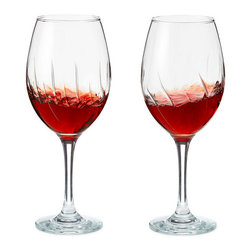 Inova Team -Modern Wine Glass - Set of 2 - The elegant, whirling design of these goblets won't just make your wine look better—they can actually make it taste better and help you feel better as you enjoy it. That's because those sinuous lines are actually ridges on the interior of the glass that aerate the wine right in your hands. There's no need to leave your bottle out to breathe before you enjoy it. Simply swirl the glass in a counter-clockwise motion, and the liquid brushes up against the ridged surface, mixing in oxygen and releasing carbon dioxide. This unlocks the aroma of red or white wine, allowing you to enjoy its fullest flavor.