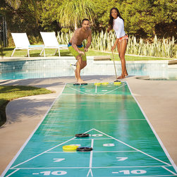 Frontgate - Portable Shuffleboard Set - Vinyl roll-out court. Four regulation cues. Four black and four yellow chip-resistant tournament disks. An ample supply of court dressing. Includes rules of play. Frontgate's Portable Shuffleboard Set arrives with everything needed for play. Stake out a clean, level surface about 40 feet in length, unroll the 27-foot reinforced-vinyl mini shuffleboard court, spray on a little friction-reducing court dressing, then grab your cues and let the disks fly. When the game's over, just roll up the court and put it away. . . . . . Made in USA.