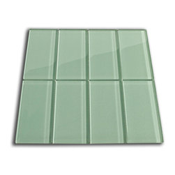 "Subway Tile Outlet - Sage Green Glass Subway Tile - The Sage Green Subway Tile is made from the strongest stain-resistant crystal clear glass. These tiles have a 8mm thickness that increases their durability and the depth of their color making them truly beautiful subway tiles. These subway tiles can be used for commercial or residential construction in either a wet or dry environment. Our Sage Glass Subway tile can be directly compared to Lush™ Surf at $21.95.    These Subway tiles are sold by the square foot comprised of 8  individual tiles. The individual tiles measure 3""x6"". This tile comes on a mesh backing for easy installation."