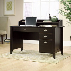 """Sauder - 36.25"""" Shoal Creek Writing Desk - Features: -Desk.-Center drawer with metal runners and safety stops.-Two outside drawers with metal runners and safety stops, lower drawer holds letter-size hanging files.-Grommet hole for cord management.-Organizer hutch with full shelf and cubbyhole storage.-Shoal Creek collection.-Desk Type: Writing Desk.-Top Finish: Jamocha Wood.-Base Finish: Jamocha Wood.-Accent Finish: Jamocha Wood.-Powder Coated Finish: No.-Gloss Finish: No.-UV Finish: No.-Top Material: Engineered wood.-Base Material: Engineered wood.-Hardware Material: Metal.-Non-Toxic: Yes.-Water Resistant: No.-Stain Resistant: Yes.-Heat Resistant: Yes.-Style: Transitional.-Design: Rectangular.-Hardware Finish: Metal.-Distressed: No.-Collection: Shoal Creek.-Eco-Friendly: Yes.-Cable Management: Yes.-Keyboard Tray: No.-Height Adjustable: No.-Drawers Included: Yes -File Drawer: Yes.-Drawer Glide Material : Metal runners with safety stops.-Safety Stop : Yes.-Soft-Close Drawer: Yes.-Locking Drawer: No.-Core Removable Drawer Locks: No.-Ball Bearing Glides: Yes.-Joinery Type : Twist lock fasteners; hidden cams and dowels.-Drawer Handle Design: Pulls and knob..-Pencil Drawer: Yes.-Jewelry Tray: No.-Exterior Shelving: Yes -Number of Exterior Shelves: 1.-Adjustable Exterior Shelving: No..-Cabinets Included: No.-Ergonomic Design: No.-Handedness: both.-Scratch Resistant: Yes.-Chair Included: No.-Legs Included: Yes -Number of Legs: 4.-Leg Material: Engineered Wood.-Leg Glides: No..-Casters Included: No.-Hutch Included: Yes.-Treadmill Included: No.-Cork Back Panel: No.-Modesty Panel: Yes -Modesty Panel Details: Half..-CPU Storage: No.-Built In Outlet: No.-Built In Surge Protector: No.-Light Included: No.-Finished Back: No.-Tipping Prevention: No.-Modular: No.-Lifestage: Teen-adult.-Application: Writing desk.-Compatibility: Any item in Shoal Creek Collection Jamocha Wood.-Commercial Use: No.-Product Care: Wipe with damp cloth.-Country of Manufacture: United States.-Weight Capacit"""