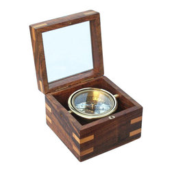 Small Gimbaled Boxed Compass w/ Beveled Glass Top - The small boxed compass is a handsome reproduction of an antique brass gimbaled compass. It comes in a beautiful hardwood box with glass top & hardwood splines. The 2 3/4-inch (7 cm) diameter compass is fully gimbaled with a solid brass gimbal set. The lid of the hardwood case is inset with beveled glass so the compass can be viewed with the lid closed, making this a beautiful addition to a nautical collection or executive's desk. The gimbaled compass is protected by a second glass cover. The hardwood case is 4 5/8 inches (11.7 cm) square and 3 1/4 inches (8.9 cm) tall, and the compass weighs 1 3/4 pounds (800 grams).