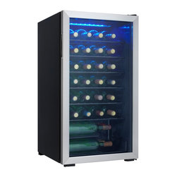 "Danby - 36 Bottle Wine Cooler - 36-bottle free-standing wine cooler, Temperature range of 6C - 14C (43F - 57F), Blue LED interior lighting beautifully showcase the wine without the heat of an incandescent bulb, Recessed pocket style handle, Black wire shelving, The tempered glass door helps to protect the wine from harmful UV rays, Smooth back design, Convenient reversible door swing for left or right hand opening, Unit dimensions 17 8/16"" W x 20 1/16"" D x 32 11/16"" H"