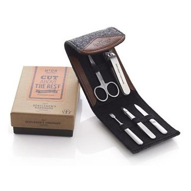 Gentleman's Manicure Set - This stylish and sophisticated men's manicure set is a cut above the rest. Set of five grooming implements includes nail trimmer, tweezers, nail file, scissors and cuticle tool, all tucked in a handsome grey felt case.
