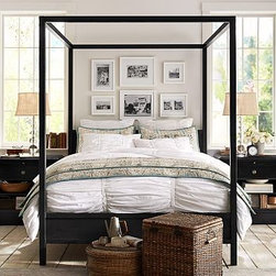 "Frances Metal Canopy Bed, King, Iron finish - A traditional design gains modern boldness in our Frances Canopy Bed. Inspired by the open industrial feel found in revitalized loft spaces, it's handcrafted at a Northern California foundry using time-honored methods. Made of welded recycled steel. Finished and distressed by hand in a powder coated Antique Bronze finish. Metal bedframe requires the use of a box spring. Made in America. Full: 56"" wide x 80"" long x 82"" high Queen: 64"" wide x 86"" long x 82"" high King: 82"" wide x 86"" long x 82"" high Cal. King: 76"" wide x 88"" long x 82"" high"