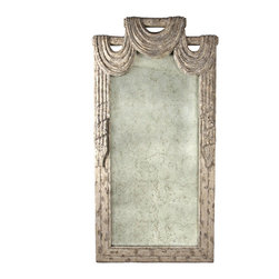 Trical Drape Mirror - Wood has been hand carved to curve elegantly in three swags above this traditionally framed antiqued mirror and flow down the sides as if it is fabric hanging. The taupe and ivory dappled finish and the relative narrowness of the size enables this mirror to be a staple of many a traditional home.