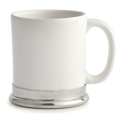 Tuscan Ceramic Mug - A narrow rolled foot of polished pewter at the base of the Tuscan Ceramic Mug lends polish and archaic interest to an otherwise updated look, creating a transitional take on a daily dishware choice. The lines of the mug are otherwise simple, making it easy to store and easy to coordinate, but the pewter is a surprisingly authentic touch that evidences the mug's handmade roots.