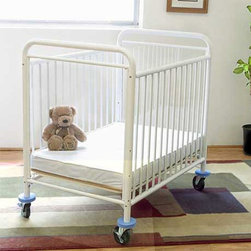 LA Baby - LA Baby Compact Metal Non Folding Crib with 3 in. Mattress - White - CS8510-W - Shop for Cribs from Hayneedle.com! They'll sleep soundly and you'll breathe easy when your little wards are resting safely and comfortably in the LA Baby Compact Metal Non Folding Crib with 3 in. Mattress - White. This sturdy steel crib is powder-coated in a non-toxic white finish that will stay clean with minimal maintenance. The adjustable mattress lets you choose from three heights to accommodate your little ones and heavy-duty rubber casters let you put the crib where you need it most. You'll have no problem checking in on them with the full-view acrylic window fastened securely to each end of the crib. Foam rubber bumpers will protect your furniture and doorways and the included mattress meets all Federal Flammability standards. Some assembly is required.About LA BabyL.A. Baby is an award-winning division of Amwan a manufacturer and distributor of fine quality juvenile furniture. With products designed for residential and commercial use L.A. Baby items can be found in homes day cares and hotels. Based in City of Industry California L.A. Baby offers a wide range of baby items including cribs strollers safety gates changing pads and high chairs.