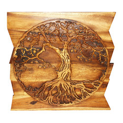 Kammika - Wall Panel Tree of Life Round on Uneven Boards 36x36x2 inch E Frdly Livos Walnut - Our Sustainable Monkey Pod Wood with Eco Friendly Natural, Food-safe Livos Walnut Oil Finish Tree of Life Round on Uneven Boards is a 36 inch x 36 inch x 2 inch thick Wall Panel that displays the concept of a many branched tree illustrating the idea that all life on earth is related. The Banyan and the Peepal trees are both considered the Trees of Life. The Banyan symbolizes fertility; it is also referred to as the Tree of Immortality. Each panel is hand carved - no two are alike. Craftspeople from the Chiang Mai area in Northern Thailand create these pieces with the simplest of tools. After each Monkey Pod wood (Acacia, Koa, Rain Tree grown for wood carving) piece is dried, carved and sanded by Thai artisans, it is rubbed in natural food-safe eco friendly Livos Walnut Oil that is polished to a water resistant and food safe matte finish. Color range is from medium to dark Walnut brown tones that will darken as the wood ages. These natural oils are translucent, so the wood grain detail is highlighted. There is no oily feel; and cannot bleed into carpets, as it contains natural lacs. This piece is made from the branches of the Acacia tree in Thailand - where each branch is cut and carved to order (allowing the tree to continue growing). The wood is dried, carved and sanded by Thai artisans. We make minimal use of electric sanders in the finishing process. All products are dried in solar or propane kilns. No chemicals are used in the process, ever. This eco friendly piece is packaged with cartons from recycled cardboard with no plastic or other fillers. The color and grain of your piece of Nature will be unique, and may include small checks or cracks that occur when the wood is dried. Sizes are approximate. Products could have visible marks from tools used, patches from small repairs, knot holes, natural inclusions or holes. There may be various separations or cracks on your pi
