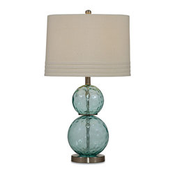 Bassett Mirror - Bassett Mirror Barika Table Lamp - Add a bit of color and texture to your space with the Barika Table Lamp. The lamp features a smooth beige drum shade with ribbon accents and a stack of two graduated spheres in blue dimple glass. Set in on a living room side table for a clean, bright look. Requires 60 watts or less, bulbs not included.