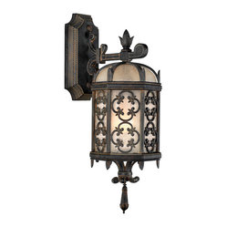 Fine Art Lamps - Costa del Sol Outdoor Wall Mount, 338581ST - Expand the pleasure you take in your outdoor space by lavishing it with light. This small yet impressive wall-mount fixture of Marbella wrought iron features a quatrefoil design and subtle iridescent textured glass.