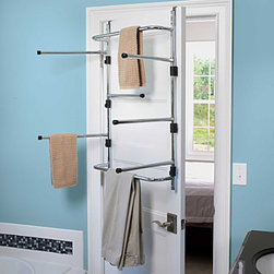 Improvements - Chrome Over The Door Dryer Rack - Use this over-the-door rack to air-dry delicates or hang clothes as you iron them. The Chrome Over-the-Door Dryer Rack has 6 swing-out arms and 2 stationary bars. This clothes drying rack is a quick and easy space-saving solution. Turn the back of a door into a complete drying center with the Chrome Over-the-Door Dryer Rack. Great for cramped laundry rooms, small apartments or dorms, the Chrome Over-the-Door Dryer Rack provides drying space just about anywhere. Just hang this metal drying rack over the door and swing out the 6 arms. The Chrome Over-the-Door Dryer Rack also has 2 stationary bars for drying towels or hanging freshly ironed shirts. The drying rack's chrome finish wipes clean easily. The Chrome Over-the-Door Dryer Rack can be left folded on your door or easily removed for storage under a bed or in a closetBenefits of the Chrome Over-the-Door Dryer Rack: