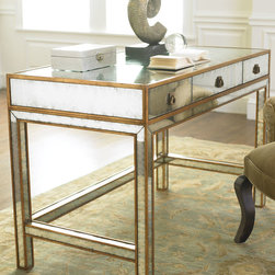 "John-Richard Collection - Mirrored Writing Desk - John-Richard CollectionMirrored Writing DeskDetailsEglomise finish with hand-painted gold wood trim.47""W x 24""D x 31""T.From the John-Richard Collection.About the John-Richard CollectionFounded in 1980 in Greenwood Mississippi the John-Richard Collection is known for a strong design staff that travels the world for inspiration. Channeling cultural and historical influences they create distinctive artisan-crafted furniture lighting wall art mirrors and decorative accessories that make a lasting impression. What's more an eye for future trends in luxury home furnishing sets the John-Richard Collection apart. They skillfully blend the best of what is new in home fashion with the great designs of the past resulting in updated designs that fit perfectly with an array of styles.Designer About the John-Richard CollectionFounded in 1980 in Greenwood Mississippi the John-Richard Collection is known for a strong design staff that travels the world for inspiration. Channeling cultural and historical influences the company creates distinctive artisan-crafted furniture lighting wall art mirrors and decorative accessories that make a lasting impression. What's more an eye for future trends in luxury home furnishing sets the John-Richard Collection apart. They skillfully blend the best of what is new in home fashion with the great designs of the past resulting in updated designs that fit perfectly with an array of styles."