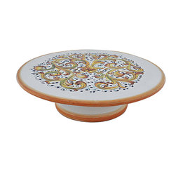 Abbiamo Tutto - Ornato Pedestal Plate - Hand formed and painted in Tuscany, Italy for Abbiamo Tutto with varying shades of amber, green and blue in a festive laurel pattern. Perfect for serving during the holiday season. Variations in color and design are part of the beauty and charm of each piece in this collection.  It is just the right size for serving during the holidays. Lead free, food safe.