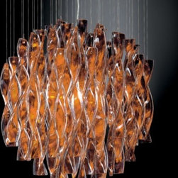 AXO Light - Avir 45/60 Suspension by AXO Light - Double-layered glass characterizes the AXO Light Avir 45/60 Suspension, diffusing and enhancing light as it passes through each individual, hand twisted piece. Crafted and hung by master Murano glass makers, this suspension, designed by Manuel Vivian, is elegant and refined, creating drama when hung low over a dining room table or bar. Italy's AXO Light combines traditional Venetian glasswork and artisan craftwork with avant-garde lighting techniques and innovative materials. Their design philosophy is clear: use creativity and inspiration to create stunning lighting replete with value and emotion.